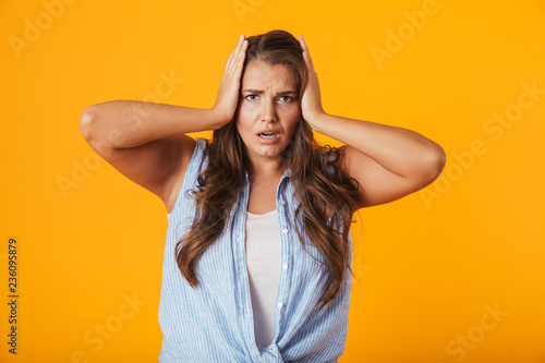 Shocked young woman standing isolated