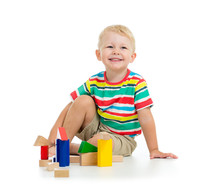Handsome Kid Boy Smiles And Plays With Colrful Blocks
