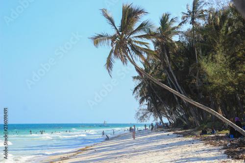 Leinwand Poster Mombasa, Kenya - December 21, 2015: Diani Beach Indian Ocean Beach - palm trees,