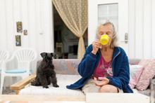 Old Woman Drinking With Dog On...