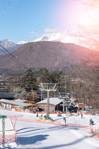 Spoed Foto op Canvas Gondolas White snow mountain background of ski slope mountain in winter resort with people in vacation skier and snowboard with ski lift chairs gondola