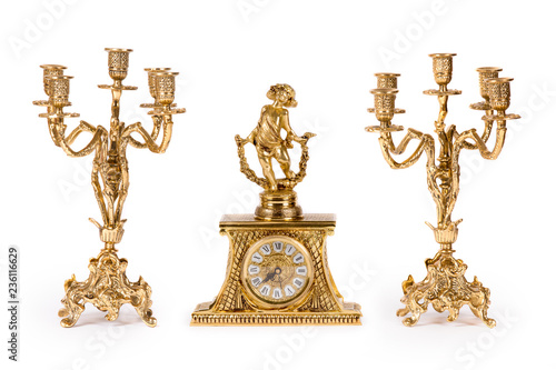 Vintage gold watch with candelabra on white background Fototapete