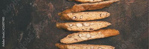 Biscotti - traditional Italian almond dessert on dark copper background Fototapeta