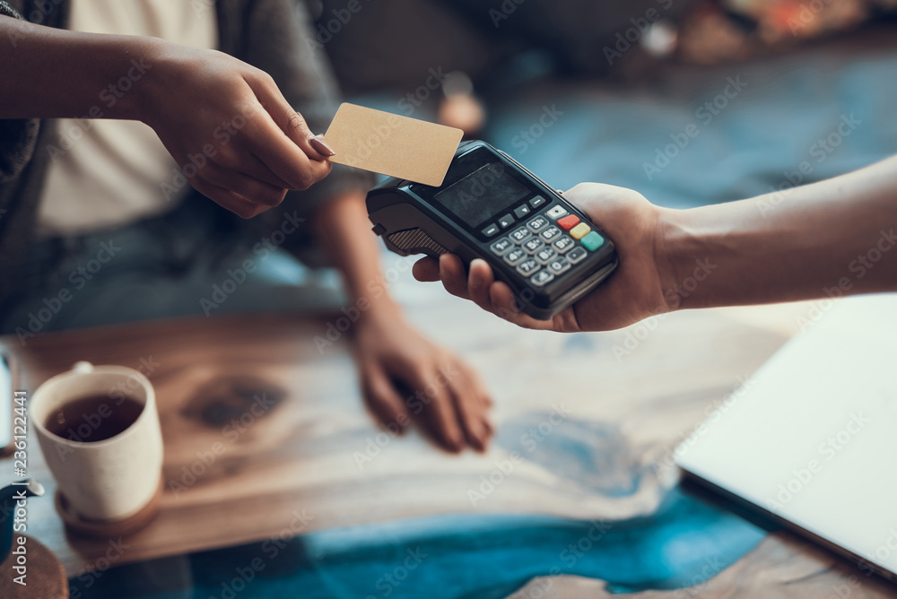 Fototapeta Woman paying with credit card