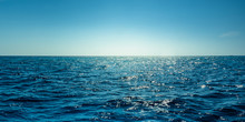 Blue Ocean Panorama With Sun Reflection, The Vast Open Sea With Clear Sky, Ripple Wave And Calm Sea With Beautiful Sunlight