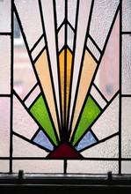 A Beautiful Bright Art Deco Stained Glass Decorative Window Panel In An An Abandoned Hotel. Art Deco Design Between 1908 To 1935. Triangular Shapes.