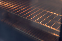 An Abstract Image Of An Orange And Red  Hot Oven Metal Rack Inside A Pre Heated Over, Ready For Baking And Cooking.