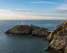 South Stack Lighthouse And Anglesey Coast In Late Afternoon Sunshine,