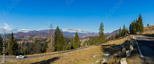landscape with the Piatra Craiului Mountains in Romania on a sunny day in November #236127471