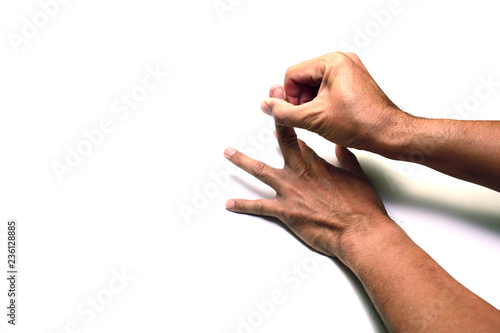 Obraz na plátne  the finger of right hand provoking the middle of left hand on white background i