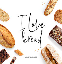"""Creative Layout Made Of  Quote """"I Love Bread"""". Flat Lay. Food Concept. Baguette, White Bread, Rye Bread And Slices On The White Background."""