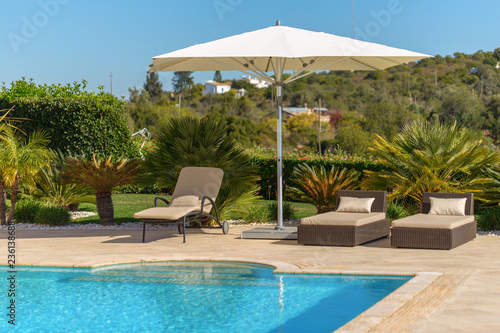 Sun bath with sun loungers and parasol. In Portugal. Wallpaper Mural