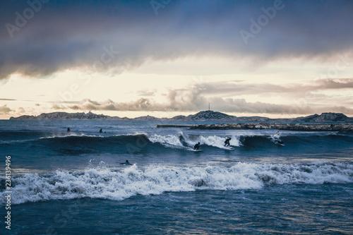 Surfers Surfing At Sunrise Mediterranean Sea Buy This