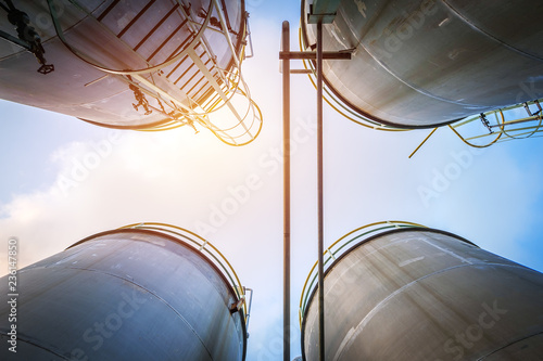 Photo Stainless tanks and pipeline for liquid chemical industrial on sky background
