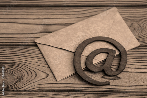 letter paper, sign the e-mail on a wooden background. Internet.