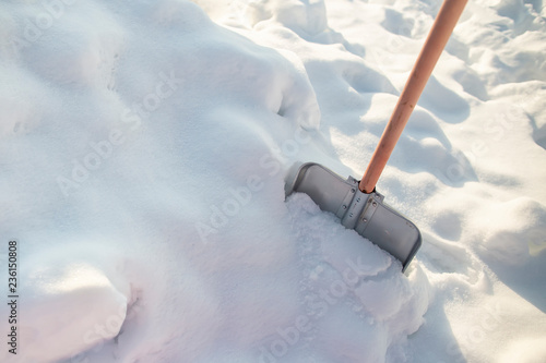 Metal Shovel With A Wooden Handle Standing In A Snowdrift On A