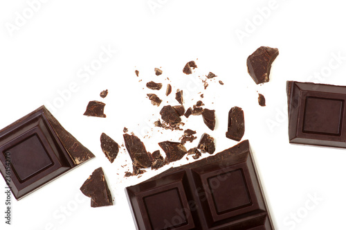 Broken chocolate bar isolated on white