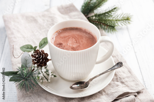 In de dag Chocolade Cup of hot chocolate on the white wooden table. Winter cocoa drink on a napkin