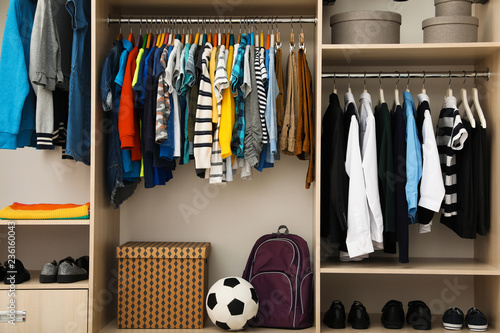 fototapeta na ścianę Large wardrobe with teenager clothes, shoes and accessories