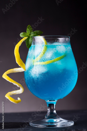 Glass of blue lagoon cocktail