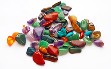 Assorted Natural Bright Coloured Semi Precious Gemstones And Gems On White Background