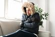 Leinwandbild Motiv A Man have cold on the sofa at home with winter coat