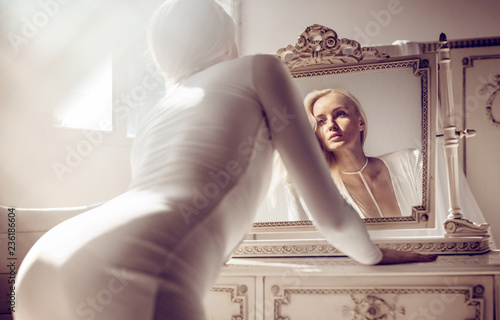 Foto op Canvas Artist KB Beautiful blond lady at the dressing table