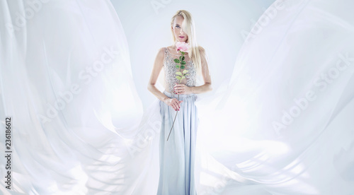 Foto op Canvas Artist KB Elegant blond woman holding a long rose flower