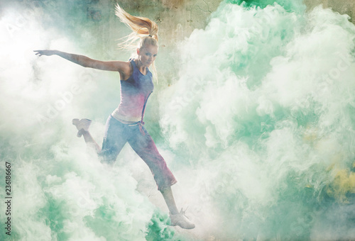 Foto op Aluminium Artist KB Portrait of a jumping dancer holding colorful flares