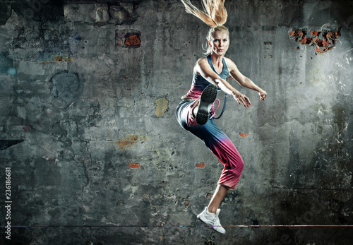 Foto op Canvas Artist KB Blonde athlete lady in a jump pose