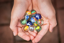 Colorful Game Marbles In The H...