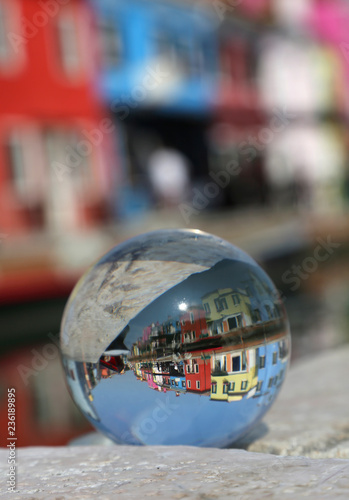 crystal ball with the colored houses of the island of Burano nea