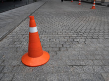 Close-up Empty Sidewalk With Restricted Parking Cone