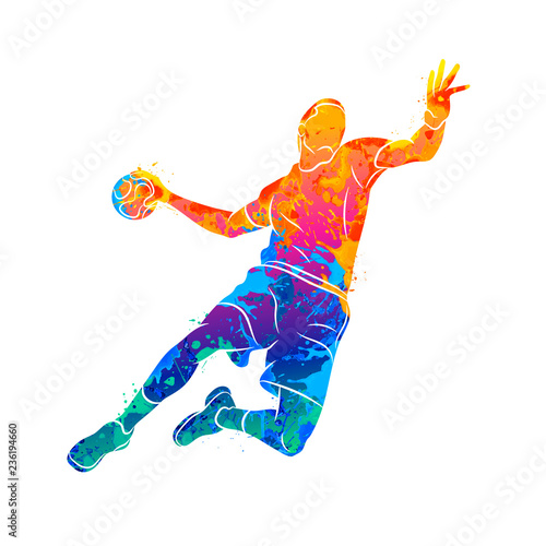 Cuadros en Lienzo Abstract handball player jumping with the ball from splash of watercolors