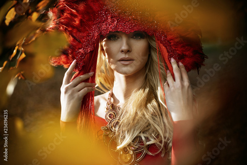 Foto op Canvas Artist KB Beautiful blond woman wearing a red coronet