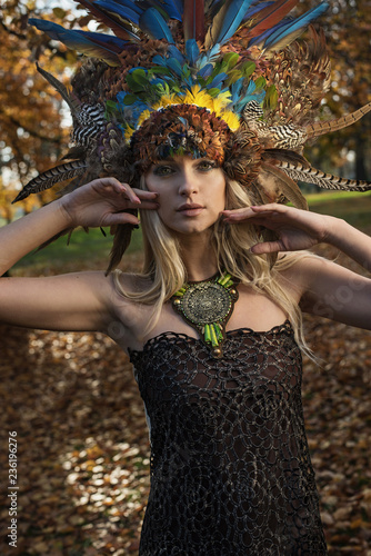 Foto op Canvas Artist KB Pretty blonde wearing coronet made of peacock's feathers