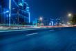 Night scene asphalt pavement and modern architecture