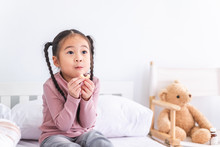 Asian Cute Little Girl Eating Sweets Cookies Snack With Happy And Enjoy