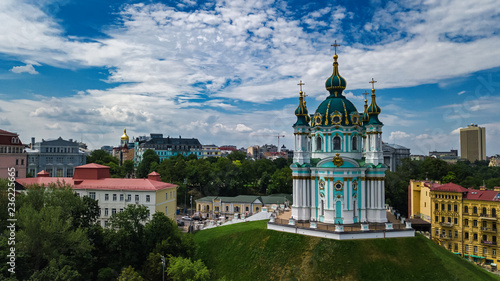 Aerial drone view of Saint Andrew's church and Andreevska street from above, cityscape of Podol district, city of Kiev (Kyiv), Ukraine