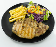 Steak Kurobuta Pork Chop Black Pepper Sauce In Plate On White Background. Props Decoration French Fries, Green Salad, Top View..