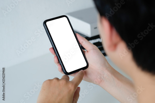 Fototapety, obrazy: Mockup smartphone montage mobile application on a man hands with clipping path.