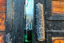 Vintage Mezuzah On Old Iron Gates With Wooden Inserts. Mezuzah - Sign Of The Jewish House In Israel And Around The World