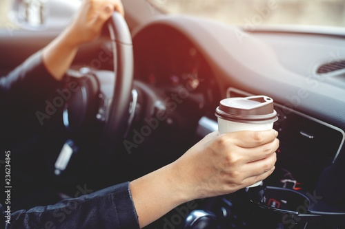 Foto auf AluDibond Kaffee people person drinking paper cup coffee of hot holding hand in a car in the morning not sleepy be energetic while driving. transportation and vehicle concept. empty copy space for text.