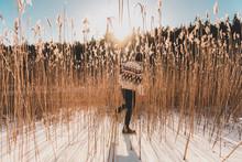 Man In Wheat Field In Snow In Sodermanland, Sweden