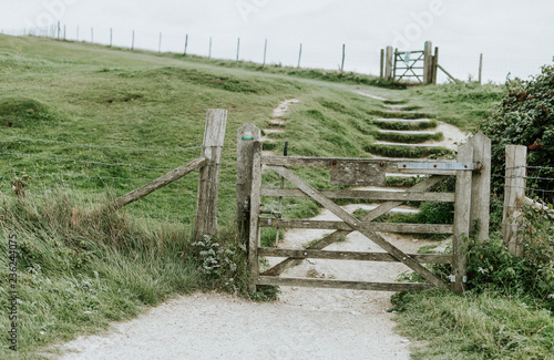Uphill walkway with wooden gates
