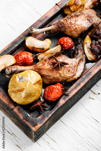 Duck legs with vegetable garnish