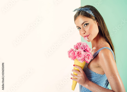 68fc2eeff2 Perfect as a flower. flower bouquet. Florist. Summer. pinup girl with  fashion hair. retro woman eating ice cream from flowers. pin up ...
