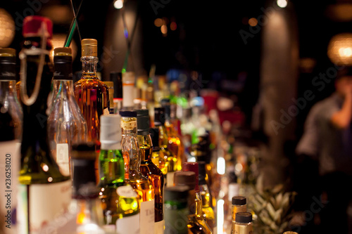Fotomural Bottles of spirits and liquor at the bar