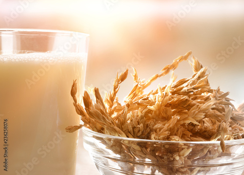 Spelt drink in glass in a rustic kitchen close up
