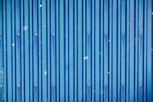 Photo Blue surface container warehouse lined with snowing